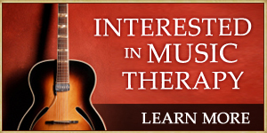 Interested in music therapy? Learn More. Image of a guitar leaned against a wall